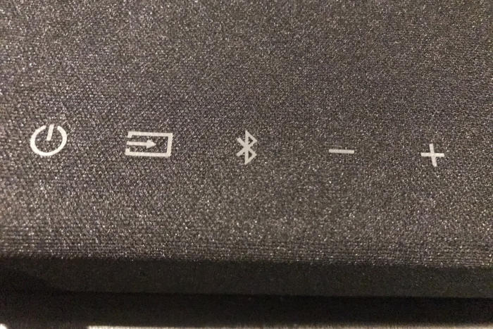 The top of the sound bar has basic, functional buttons.
