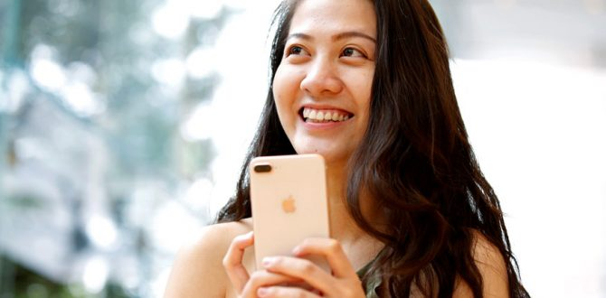 woman holds Apples new iPhone 8 Plus 670x330 - Apple to Respond to US Probes Into Slowdown of Old iPhones