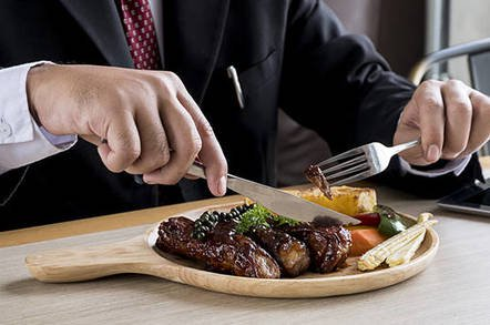 steak dinner shutterstock - Yay, you've won your Fitbit lawsuit, folks. But, lawyers, about those filet mignon expenses…