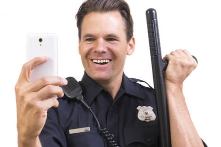 shutterstock police selfie - US prison telco accused of selling your phone's location to the cops